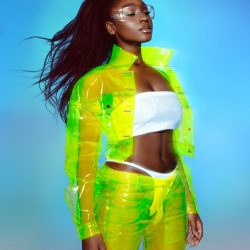 Normani kordei green outfit background