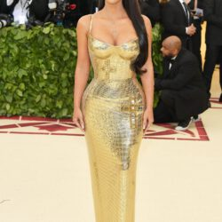 Kim k wearing gold outfit