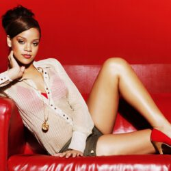 Rihanna on red couch