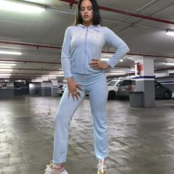 Wearing light blue outfit